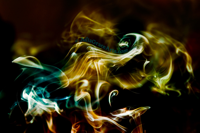 Colorful photograph of wisps and swirls of smoke