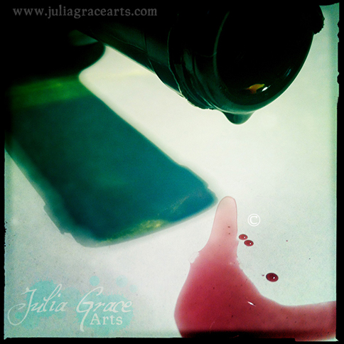 Red wine dripping from the bottle
