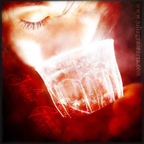 Woman drinking glowing red wine from a glass