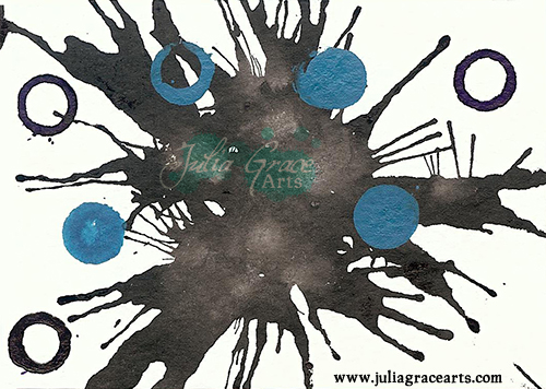 Black, teal, and purple ink blown on paper
