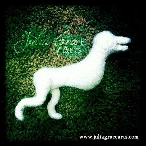 Adding and shaping the back legs of border collie needle felted sculpture