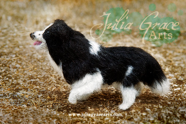 Wool sculpture border collie with raised paw