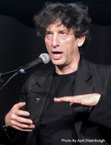 Neil Gaiman telling a dirty joke in a funny voice with a dorky face